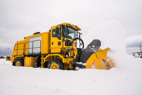 Oshkosh Snow Products Dual Action Blower Throwing Snow