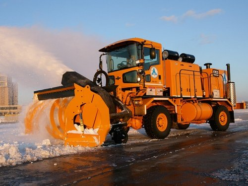 Oshkosh Snow Products H-Series Chassis throwing snow